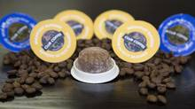 A biodegradable single serve coffee pod at Coffee Club Coffee, a 108-yr-old coffee maker for major brands, in Toronto, Ontario on Aug. 21, 2014. (Peter Power for The Globe and Mail)