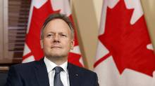 New Bank of Canada Governor Stephen Poloz sits in Canada's Prime Minister Stephen Harper's Langevin Block office in Ottawa in this June 3, 2013, file photo. (CHRIS WATTIE/REUTERS)