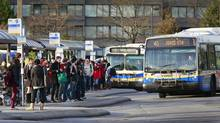 Students line up to catch a bus at the UBC bus loop in Vancouver in November 2012. UBC is urging the city to advocate for a rapid-transit line from Commercial Drive to the university along Broadway right away. (Jeff Vinnick for The Globe and Mail)