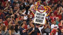 A fan holds a sign during game one of the American League Divison Series between the Boston Red Sox and the Cleveland Indians at Progressive Field on October 6, 2016 in Cleveland, Ohio. (Jason Miller/Getty Images)