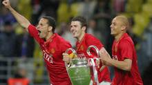 Manchester United's captain Rio Ferdinand (L) and Wes Brown run with the trophy after beating Chelsea in the final of the UEFA Champions League football match at the Luzhniki stadium in Moscow on May 21, 2008. The match remained at a 1-1 draw and Manchester won on penalties after extra time. Getty Images / Alexander Nemenov (Alexander Nemenov/Getty Images)