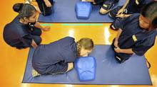 Students at Senator O'Connor College School in Toronto practise CPR. (J.P. MOCZULSKI/J.P. MOCZULSKI/The Globe and Mail)