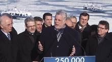 Quebec Liberal Leader Philippe Couillard gestures during a maritime program announcement Friday March 7,2013 in Levis, Que. (CLEMENT ALLARD/THE CANADIAN PRESS)