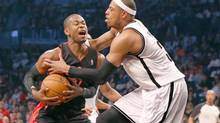 Brooklyn Nets forward Paul Pierce (34) fouls Toronto Raptors forward Terrence Ross (31) during the first quarter in game three of the first round of the 2014 NBA Playoffs at Barclays Center. (Anthony Gruppuso/USA Today Sports)