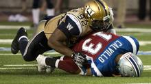 Winnipeg Blue Bombers defensive tackle Bryant Turner sacks Montreal Alouettes quarterback Anthony Calvillo during third quarter CFL action in Montreal on July 4, 2013. (Paul Chiasson/THE CANADIAN PRESS)
