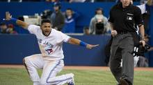 Toronto's Melky Cabrera, left, reacts after being called out by umpire Mike Winters in the first inning against Baltimore in Toronto Thursday. (Nathan Denette/THE CANADIAN PRESS)
