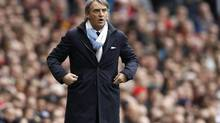 Manchester City's manager Roberto Mancini reacts during their English Premier League soccer match against Arsenal at the Emirates Stadium in London April 8, 2012. (STEFAN WERMUTH/REUTERS)