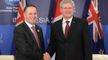 Prime Minister Stephen Harper takes part in a bilateral meeting with New Zealand Prime Minister John Key during the APEC summit in Nusa Dua, Bali, Indonesia on Monday, October 7, 2013. (Sean Kilpatrick/THE CANADIAN PRESS)