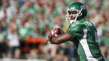 Saskatchewan Roughriders quarterback Darian Durant looks to make a pass against the Hamilton Tiger-Cats during the first half of CFL action at Mosaic Stadium on Sunday, July 21, 2013 in Regina. (Liam Richards/THE CANADIAN PRESS)