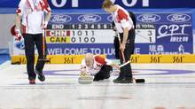 Canada's skip Kevin Koe delivers a shot between his teammates during a match against China at the World Men's Curling Championships in Beijing March 30, 2014. (CHINA DAILY/REUTERS)