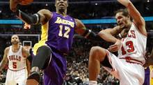 Los Angeles Lakers centre Dwight Howard (12) pushes Chicago Bulls center Joakim Noah (13) away from a rebound during the second half of an NBA basketball game Monday, Jan. 21, 2013, in Chicago. (Charles Rex Arbogast/AP)