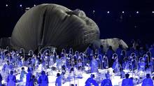 Actors perform in a sequence meant to represent Britain's National Health Service perform during the Opening Ceremony at the 2012 Summer Olympics, July 27, 2012, in London. (Jae C. Hong/AP)