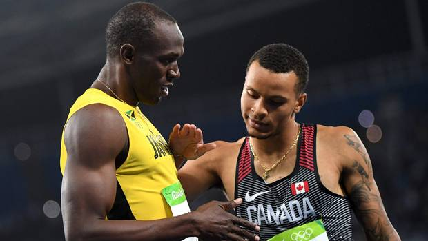 Jamaica's Usain Bolt shakes hands with silver medalist Andre De Grasse of Canada after the men's 200-metre final on Aug. 18, 2016.