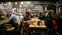 Hamilton has seen a growing number of new restaurants opened by Toronto chefs, including Hambrgr. (photos by Glenn Lowson/The Globe and Mail)