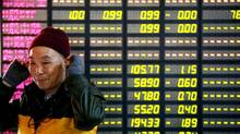 The many global investors who track the indices compiled by the likes of FTSE and MSCI would be forced to buy into the Chinese market were it added to global and regional benchmarks, or had its weighting increased. (AP)