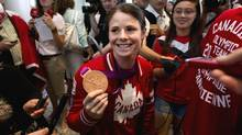 Olympian Diana Matheson arrives at Toronto's Pearson Airport on Monday. Matheson scored the winning goal in Canada's match against France to win the Olympic bronze medal in women's soccer. (Moe Doiron/The Globe and Mail)