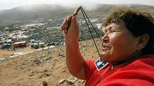 A woman prays near the mining encampment at Copiapo, Chile, October 9, 2010. (HECTOR RETAMAL/AFP/Getty Images)