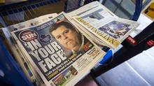 Toronto Sun and National Post newspapers are seen on a news stand in Toronto on October 6, 2014. Print circulation revenue fell 6.5 per cent and digital revenue slipped 4 per cent for the quarter. (MARK BLINCH/REUTERS)