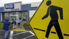 Shoppers enter the Lands' End Inlet store in Rochester, N.Y. (DAVID DUPREY/AP)