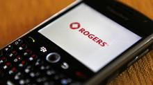 A Blackberry smartphone on the Rogers wireless network is seen in Montreal, October 26, 2010. BCE?s Bell Canada, Rogers Communications and Telus Corp -- Canada?s ?Big Three? telecoms -- command profit margins that are the envy of the industry. (SHAUN BEST/REUTERS)