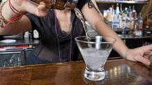 Bartender pouring a drink (Thinkstock)