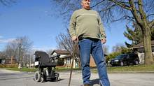 Steve Garvie who can now walk without his wheelchair after undergoing Italian doctor Zamboni's neck vein surgery to cure his multiple sclerosis, walks outside his home in Barrie, Ont. (J.P. MOCZULSKI/The Globe and Mail)