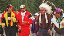 Gino Odjick, left, of the Vancouver Canucks and Sandy McCarthy, second from left, of the Calgary Flames lead the start of the Spiritual Journey of Healing Run from the Tsuu T'ina Reserve near Calgary to the Musquean Reserve near Vancouver in 1995. (John Gibson/Calgary Sun/The Canadian Press)