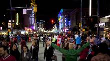 Granville Street has been jam-packed with visitors, buskers and entertainers during the Winter Games. (Rafal Gerszak for The Globe and Mail)