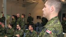 Canadian forces sit in the lounge and wait at CFB Trenton, in Trenton, Ont., on Sunday April 26, 2015. (Lars Hagberg/THE CANADIAN PRESS)
