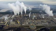 Syncrude's oil sands upgrader north of Fort McMurray, Alta in an aerial photograph Aug. 31, 2010. (Kevin Van Paassen/The Globe and Mail)