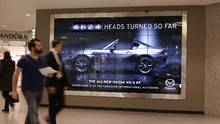 Mazda Canada's new ad, promoting the MX-5 RF convertible, uses a camera to track in real time the number of times someone turns their head to look at the image. (Mazda Canada)