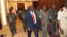 Michel Djotodia, centre, the rebel leader who declared himself president of the Central African Republic over the weekend after his soldiers seized the capital, arrives for a meeting with members of the government armed forces in the capital Bangui, Thursday, March 28, 2013. (AP)