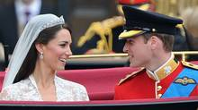 The just-married Prince William, Duke of Cambridge, and Catherine, Duchess of Cambridge, exchange pleasantries in the carriage on the way from Westminster Abbey to Buckingham Palace. (Pascal Le Segretain/Getty Images)