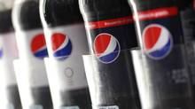 Pepsi bottles are seen on display in New York. (SHANNON STAPLETON/REUTERS)