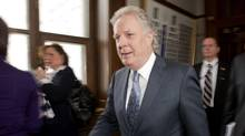 Quebec Premier Jean Charest walks form question period toward his office Wednesday, February 9, 2011 at the legislature in Quebec City. (Jacques Boissinot/The Canadian Press/Jacques Boissinot/The Canadian Press)