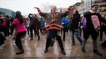 Women dance outside the Vancouver Art Gallery as part of the One Billion Rising anti-violence, justice and gender equality movement in Vancouver on Feb. 14, 2013. (DARRYL DYCK FOR THE GLOBE AND MAIL)