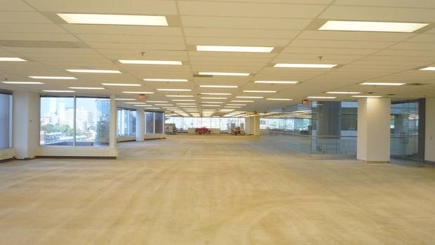 After its previous tenant moved out, the 30,000-square-feet of space on the seventh floor of 901 King St. West in Toronto looked vast and unloved when Ted Shore, a principal at Quadrangle Architects Ltd., took his first tour. Despite acres of dirty beige carpet and acoustic-tile ceilings that significantly reduced the interior's height, the firm decided the building had 'good bones' and could be refitted to become its new home. (Quadrangle Architects)
