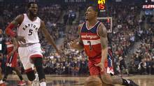 Toronto Raptors forward DeMarre Carroll, left, defends against Washington Wizards guard Bradley Beal in a game at Air Canada Centre. (Nick Turchiaro/USA Today Sports)