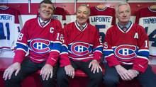 From left, Montreal Canadiens' Big 3 defencemen, Serge Savard, Guy Lapointe and Larry Robinson, pose for photos at the Canadiens' Hall of Fame in Montreal, Thursday, June 19, 2014. (Graham Hughes/THE CANADIAN PRESS)