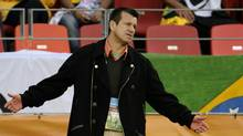 Brazil's coach Dunga reacts during the 2010 World Cup quarter final Netherlands vs Brazil on July 2, 2010 at Nelson Mandela Bay stadium in Port Elizabeth. Dunga admitted he would have to take the rap for Brazil's World Cup heartbreak and that his four-year reign as coach had ended with a quarter-final defeat at the hands of the Netherlands. (FABRICE COFFRINI/AFP/Getty Images)