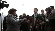Adrian Dix held his news conference near the Olympic Cauldron because of rules against use of caucus offices for party events. (Deborah Baic/The Globe and Mail)