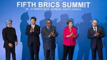 From left to right: Indian Prime Minister Manmohan Singh, Chinese President Xi Jinping, South African President Jacob Zuma, Brazilian President Dilma Rousseff and Russian President Vladimir Putin applaud at a photo session during the fifth BRICS Summit in Durban, South Africa, on March 27, 2013. (ROGAN WARD/Reuters)