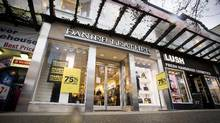 Sale signs are displayed outside of a Danier Leather store in downtown Vancouver, British Columbia, Canada, Feb. 4, 2016. (Ben Nelms/Bloomberg)