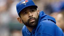 Toronto Blue Jays' Jose Bautista, who is on the disabled list with a wrist injury, looks into the stands between innings during a American League baseball game against the Tampa Bay Rays in St. Petersburg, Florida, August 9, 2012. (STEVE NESIUS/REUTERS)