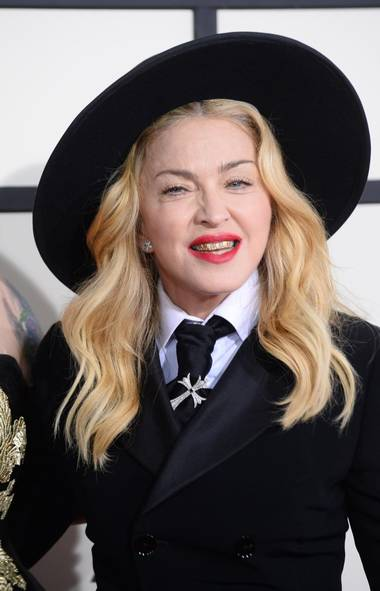 Madonna wears a grill as she arrives at the 56th annual Grammy Awards at Staples Center on Sunday, Jan. 26, 2014, in Los Angeles. (Jordan Strauss/Invision/AP)