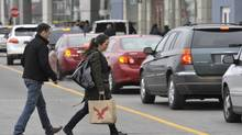 Holiday shoppers navigatea busy parking lot at Yorkdale Mall in Toronto on a mild Dec. 15, 2012. (J.P. MOCZULSKI for The Globe and Mail)