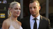 A Nov. 4, 2012 photo shows South African Olympic athlete Oscar Pistorius and Reeva Steenkamp, believed to be his girlfriend, at an awards ceremony in Johannesburg. (Lucky Nxumalo-Citypress/AP)