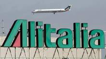 An Alitalia jet makes a landing approach at Fiumicino airport in Rome in 2008. The cash-strapped Italian airline is expected to unveil its first mass hiring since 2008 in an effort to lure investors. (CHRIS HELGREN/REUTERS)