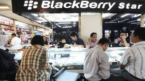 People buy Blackberry phones in a handphone shop at the International Trade Centre Ambassador shopping mall in Jakarta, Indonesia.