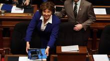 Premier Christy Clark arrives before B.C. Finance Minister Michael de Jong arrives to deliver a balanced budget for a fifth year in a row at Legislative Assembly in Victoria, B.C. Tuesday, February 21, 2017. (CHAD HIPOLITO/THE CANADIAN PRESS)